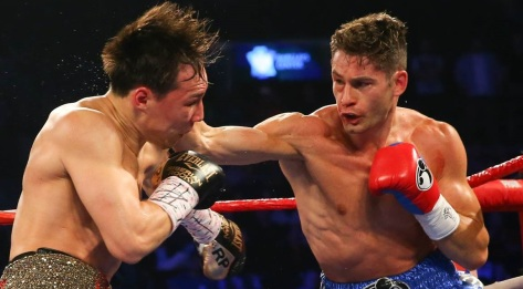 While Chris Algieri, right, typically landed fleeting jabs -- like this one -- on Ruslan Provodnikov at Saturday's World Boxing Organization junior welterweight championship bout, he was still able to return home a champion. (Photo/Ed Mulholland/HBO)