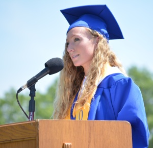 The valedictorian of Northport's class of 2014, Nicole Hawkins, addresses the crowd and her fellow graduates during Saturday's commencement ceremony.