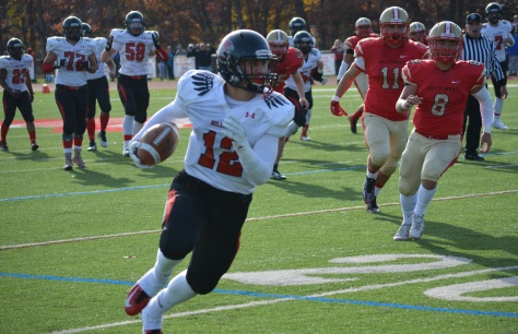 Nick DiPietro, a Hills East junior, makes a big grab for the Thunderbirds on Saturday that set up his team's lone touchdown in the game.
